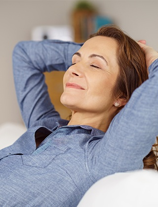 Relaxing woman with hands behind her head